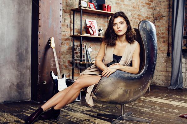 Fiatal csinos nő vár egyedül modern padlás Stock fotó © iordani