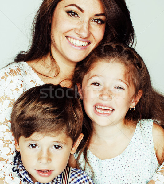 young mother with two children on white, happy smiling family in Stock photo © iordani