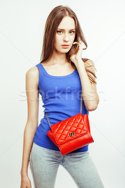 young pretty long hair woman happy smiling isolated on white background, wearing cute tiny handbag,  Stock photo © iordani