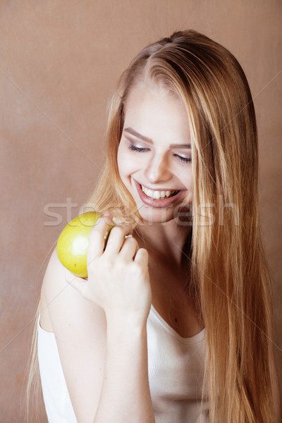 Jonge mooie blond vrouw groene appel Stockfoto © iordani