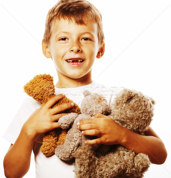 little cute boy with many teddy bears hugging isolated close up Stock photo © iordani