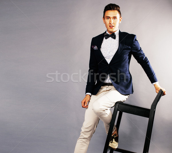 young handsoman businessman fooling aroung with chair Stock photo © iordani