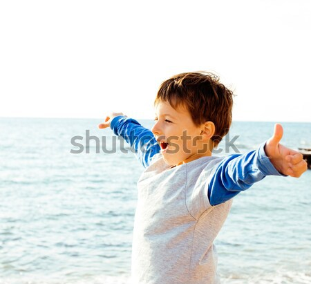 little cute boy on sea coast thumbs up Stock photo © iordani