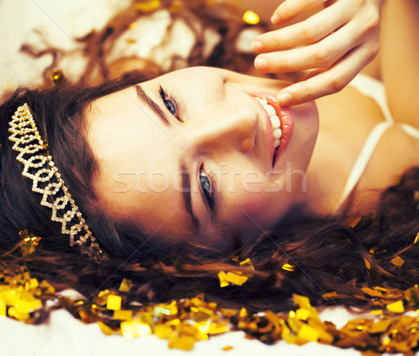 beauty young girl in gold confetti and tiara, little princess celebration Stock photo © iordani