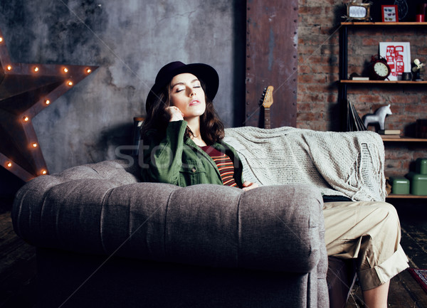 young pretty woman waiting alone in modern loft studio, fashion musician concept, lifestyle people Stock photo © iordani