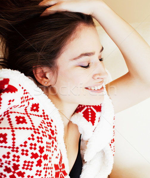 young pretty real woman in sweater and winter blanket all over her face smiling at home, lifestyle p Stock photo © iordani