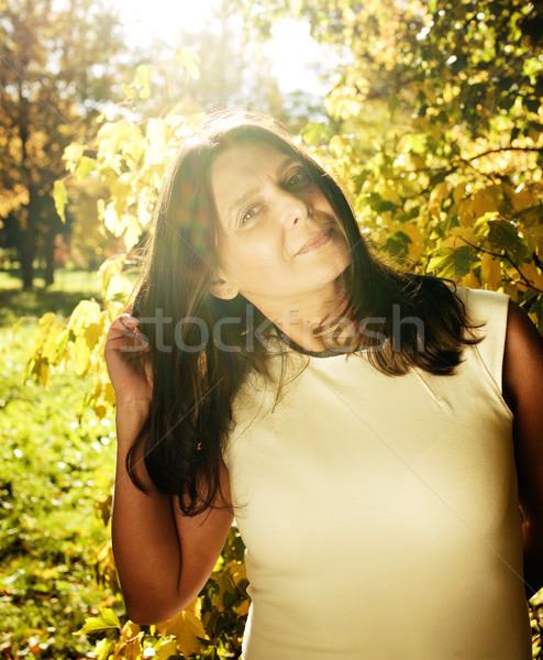 成熟した 本当の ブルネット 女性 緑 春 ストックフォト © iordani