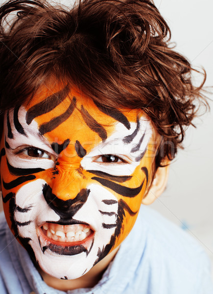 little cute boy with faceart on birthday party close up, little cute tiger Stock photo © iordani