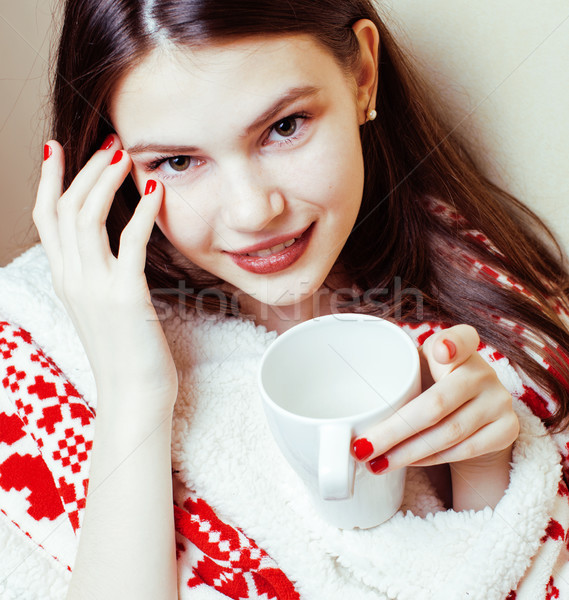 Stock photo: young pretty brunette girl in Christmas ornament blanket getting warm on cold winter, freshness beau
