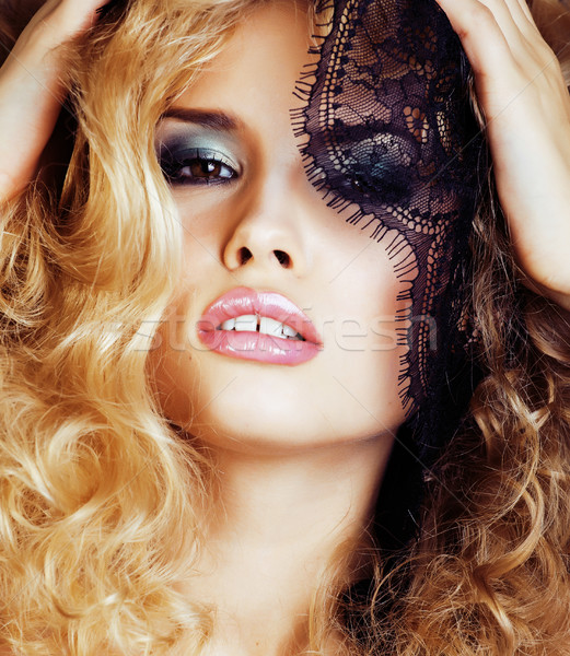 Portrait of beauty blond young woman through black lace close up sensual seduction Stock photo © iordani