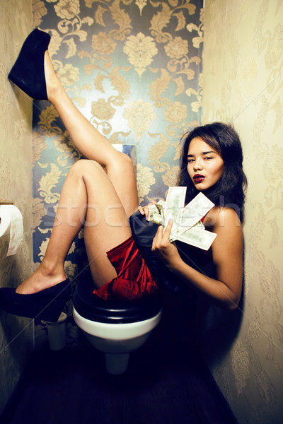pretty young african american woman in luxury restroom with mone Stock photo © iordani
