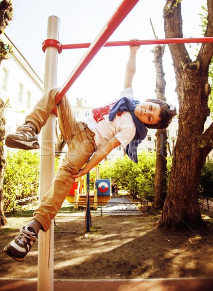 Kicsi aranyos szőke fiú akasztás játszótér Stock fotó © iordani