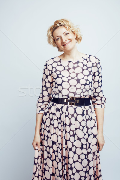 mature blond curly woman cheerful posing on white background isolated, lifestyle people concept Stock photo © iordani