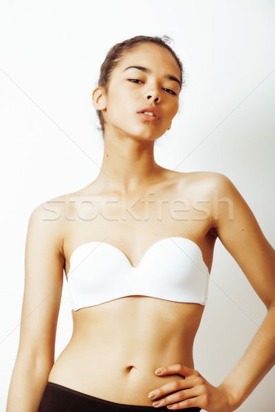 Stock photo: young pretty african american woman close up isolated on white background, asian mulatto tanned nude