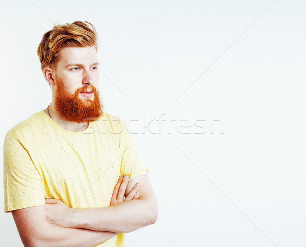 portrait of young bearded hipster guy smiling on white backgroun Stock photo © iordani