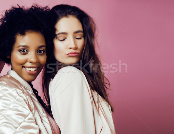 different nation girls with diversuty in skin, hair. scandinavian, african american cheerful emotion Stock photo © iordani