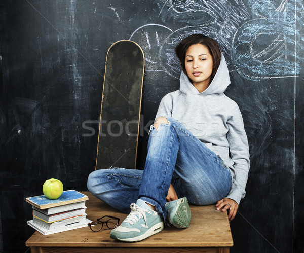 young cute teenage girl in classroom at blackboard seating on ta Stock photo © iordani