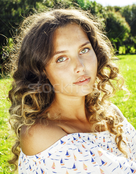 young cute summer girl on green grass outside relaxing smiling c Stock photo © iordani