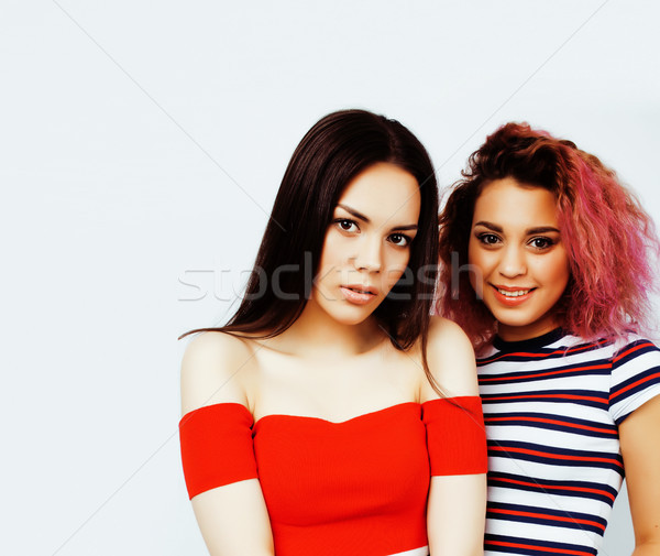 lifestyle people concept: two pretty stylish modern hipster teen girls having fun together, diverse  Stock photo © iordani