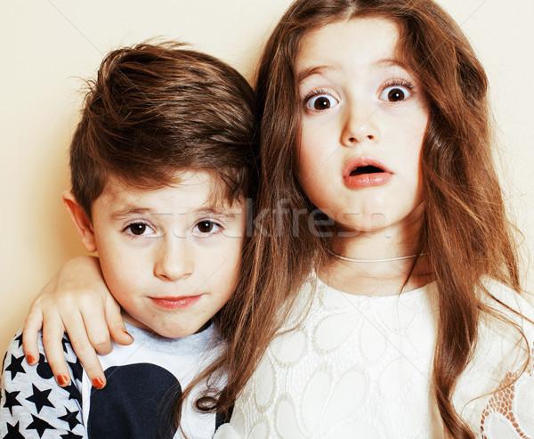 Kicsi aranyos fiú lány ölel játszik Stock fotó © iordani
