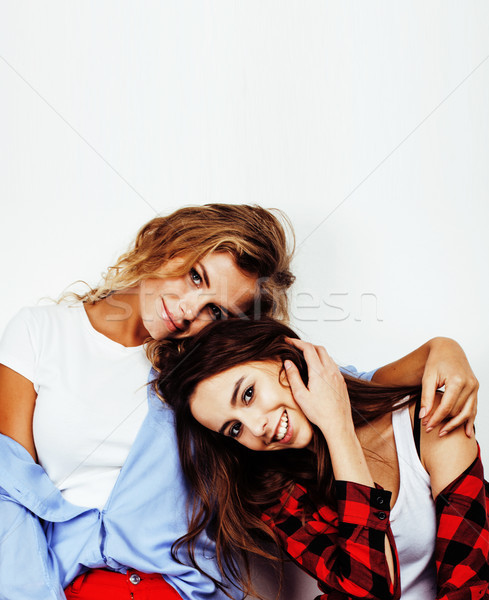 Stock photo: best friends teenage girls together having fun, posing emotional on white background, besties happy
