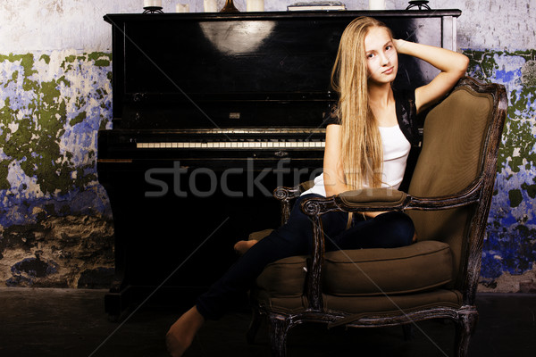 pretty young blond real girl at piano in old-style rusted interi Stock photo © iordani