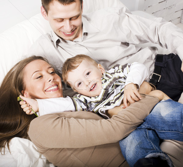 young happy modern family smiling together at home. lifestyle people concept, father holding baby so Stock photo © iordani