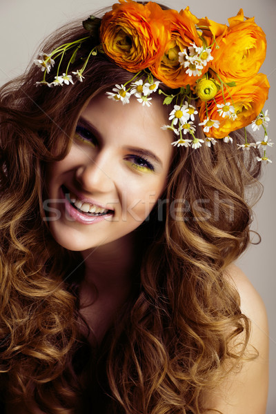Beauty young woman with flowers and make up close up, real sprin Stock photo © iordani