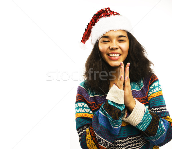 cute young girl in santas red hat isolated Stock photo © iordani