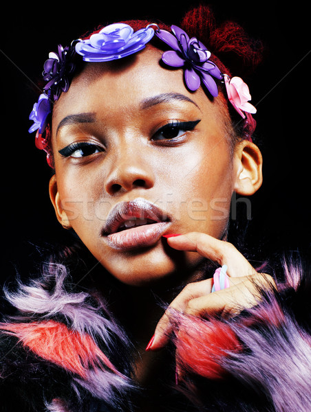 young pretty african american woman in spotted fur coat and flow Stock photo © iordani