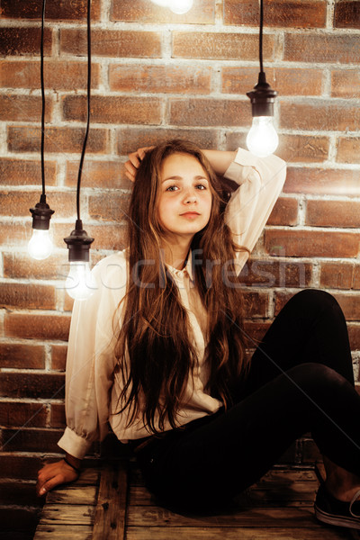 pretty teenage girl having fun in stylish modern loft studio, lifestyle people concept Stock photo © iordani