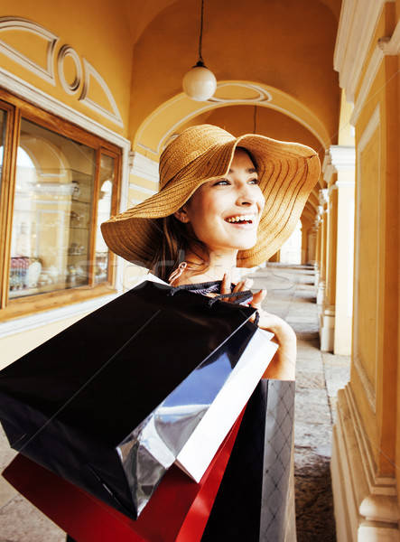 young pretty smiling woman in hat with bags on shopping at store Stock photo © iordani