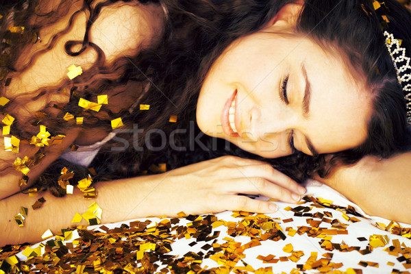 Stock photo: beauty young girl in gold confetti and tiara, little princess ce