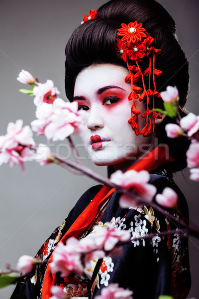 young pretty geisha in kimono sakura view Stock photo © iordani