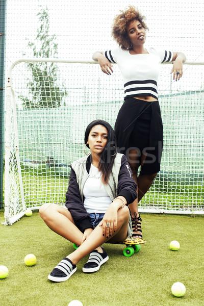 Fiatal csinos nemzetiség lányok szórakozás mező Stock fotó © iordani