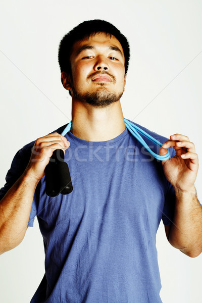 young asian guy with skipping rope on white background ready to  Stock photo © iordani