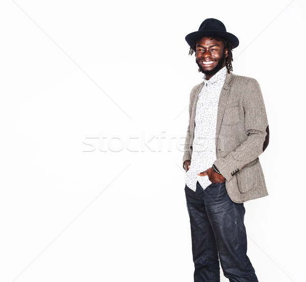 young handsome afro american boy in stylish hipster hat gesturin Stock photo © iordani