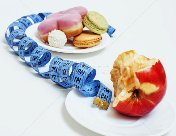 new real diet concept, question sign in shape of measurment tape between red apple and donut isolate Stock photo © iordani