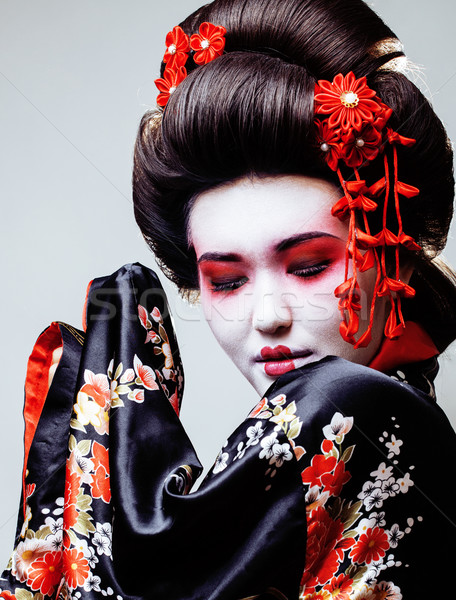 young pretty geisha in black kimono among sakura, asian ethno close up Stock photo © iordani