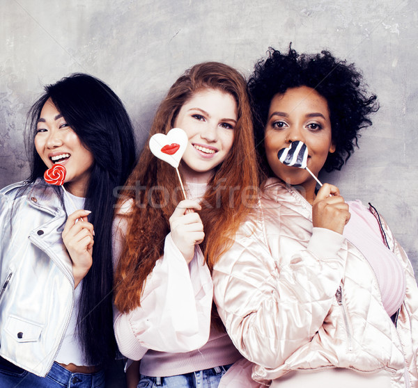 Lifestyle and people concept: young pretty diversity nations woman with different age children celeb Stock photo © iordani