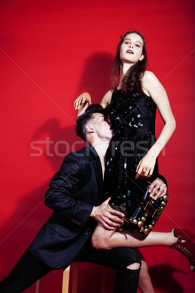 young fashion style couple man and woman on red sexy background, luxury stuff, lifestyle modern peop Stock photo © iordani