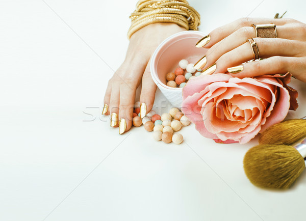 woman hands with golden manicure  many rings holding brushes, make up artist stuff stylish and pure Stock photo © iordani