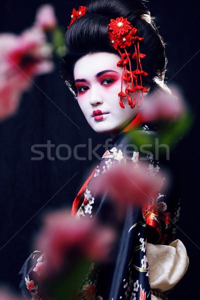 Fiatal csinos igazi gésa kimonó sakura Stock fotó © iordani