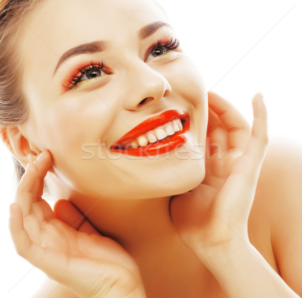 young blond woman with bright make up smiling pointing gesturing Stock photo © iordani