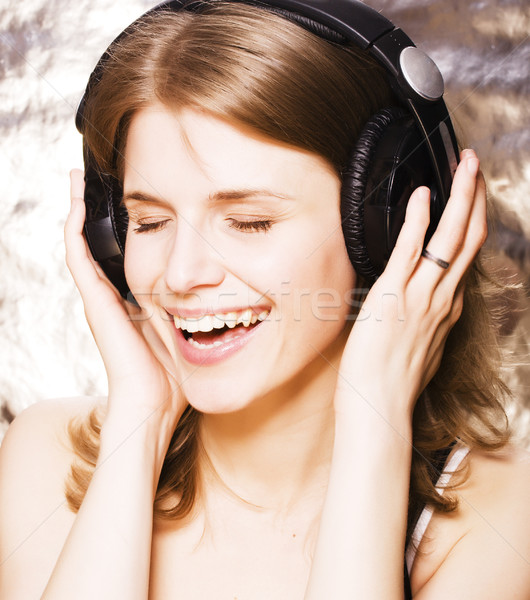 young pretty woman in headphones listening music, singing a song happy smiling, lifestyle people con Stock photo © iordani