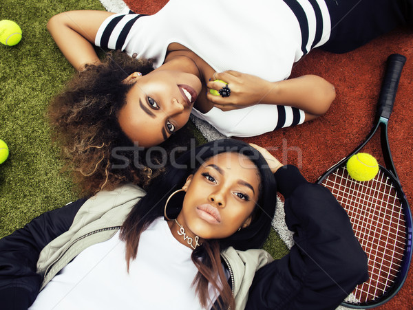 Stock photo: young pretty girlfriends hanging on tennis court, fashion stylis
