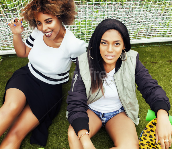 young pretty multi ethnicity afro-american girls having fun on f Stock photo © iordani