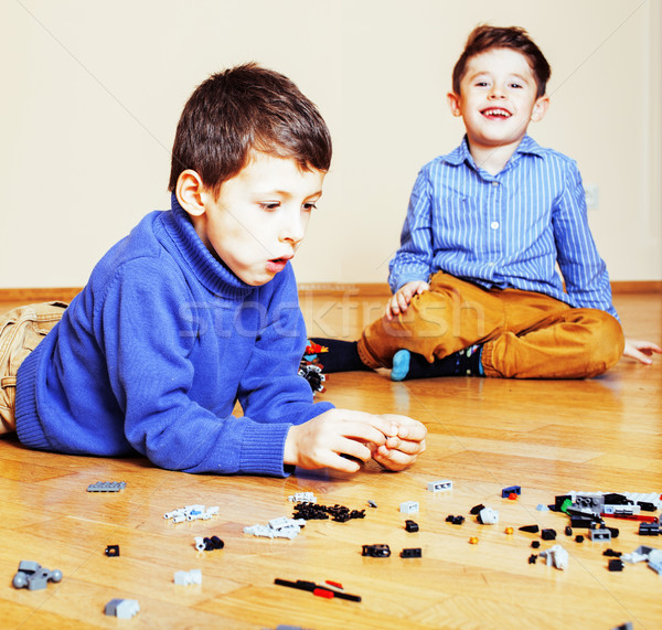 funny cute children playing toys at home, boys and girl smiling, Stock photo © iordani