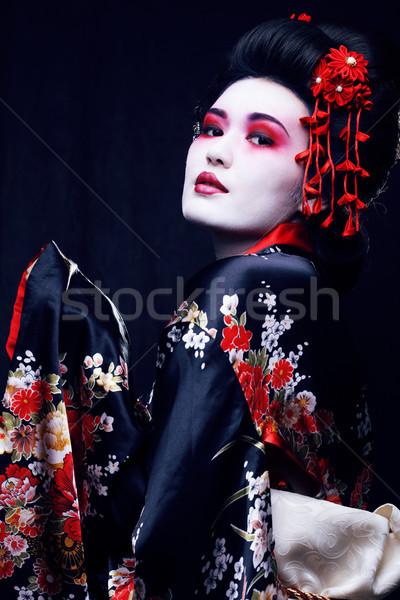 young pretty geisha in kimono with sakura and decoration Stock photo © iordani