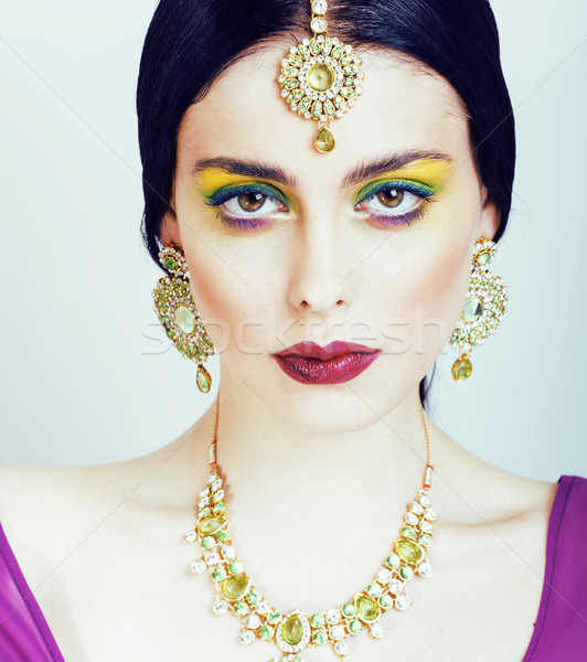 young pretty caucasian woman like indian in ethnic jewelry close up on white, bridal bright makeup f Stock photo © iordani